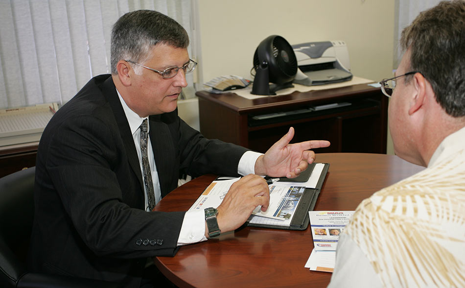 Gary Capolino working with a client's business accounting